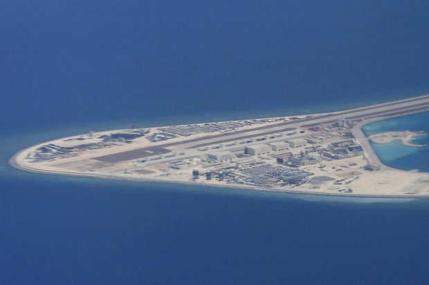 An airstrip, structures and buildings on China's man-made Subi Reef in the Spratly chain of islands in the South China Sea are seen from a C-130 transport plane of the Philippines Air Force. (File photo via AP)