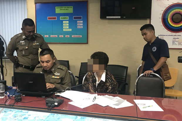 Tatchakrit Wonglaemthong, 23, acknowledges a charge of computer crime at the Pattaya police station in Chon Buri province on Tuesday, for posting online a video clip from a pool party last Saturday. (Photo by Chaiyot Pupattanapong)