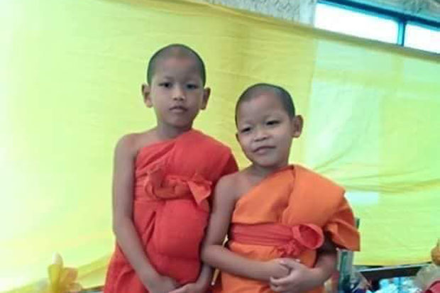 Wathanapol Seesawat, left, poses for a picture as a new novice. He was fatally  assaulted by his 64-year-old mentor monk. (Photo by Piyarach Chongcharoen)