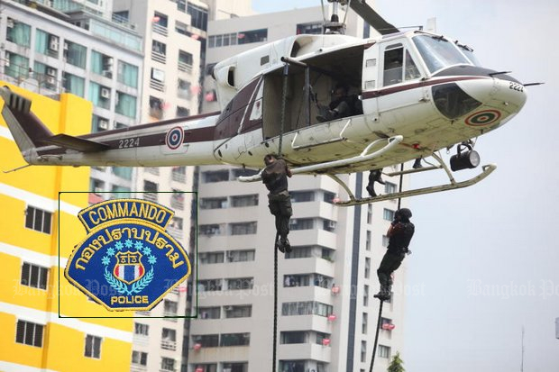 The commando unit of the Crime Suppression Division practice an anti-terrorism 'fast rope exit' manoeuvre during training. (Bangkok Post file photo by Pattanapong Hirunard)