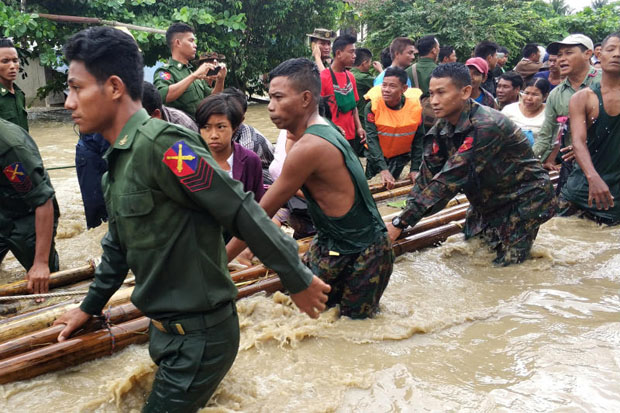 People are evacuated by Myanmar soldiers after flooding in Swar township, Myanmar, on Wednesday. (Reuters photo)