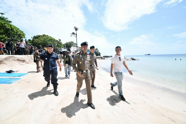 Deputy tourist police chief Surachate 'Big Joke' Hakparn walked the beach, interviewed witnesses and held a public meeting during his fact-finding trip to Koh Tao on Wednesday. (Photo courtesy Tourist Police)