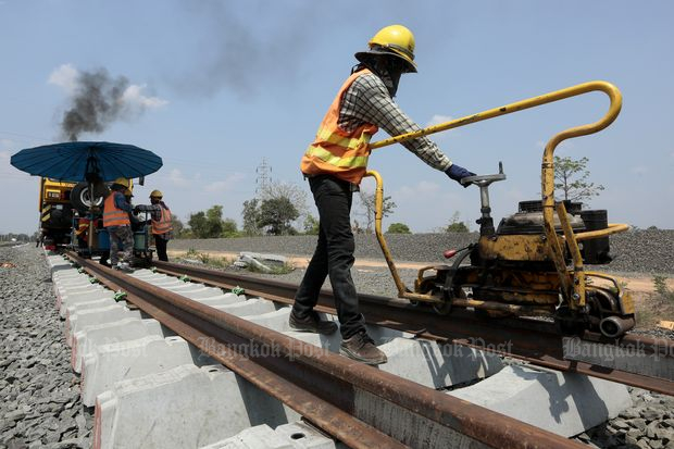 Workers weld rails during the construction of the Jira-Khon Kaen double-track railway at Ban Kradon station in Muang district, Nakhon Ratchasima province, on March 30 this year. The construction is part of the 23.4-billion-baht 187km railway project in collaboration with China. (Photo by Patipat Janthong)