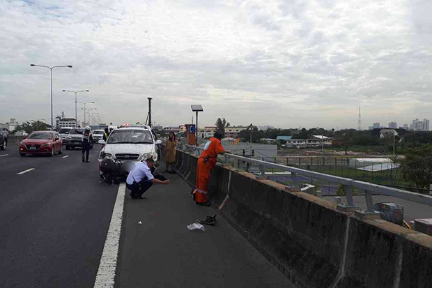 Woman falls to death from expressway after hit by SUV