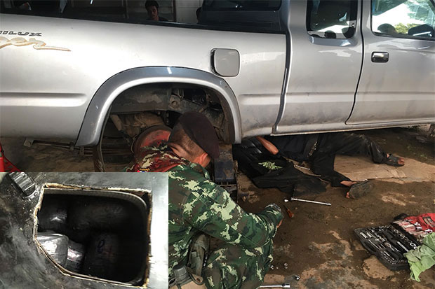 Soldiers search the pickup truck and find drugs hidden in a secret compartment at a checkpoint in Sangkhla Buri district, Kanchanaburi, on Thursday evening. A short time before, the same team had caught a 77-year-old Thai man driving a car also smuggling methamphetamine pills and crystal meth from the nearby border. (Photo by Piyarach Chongcharoen)