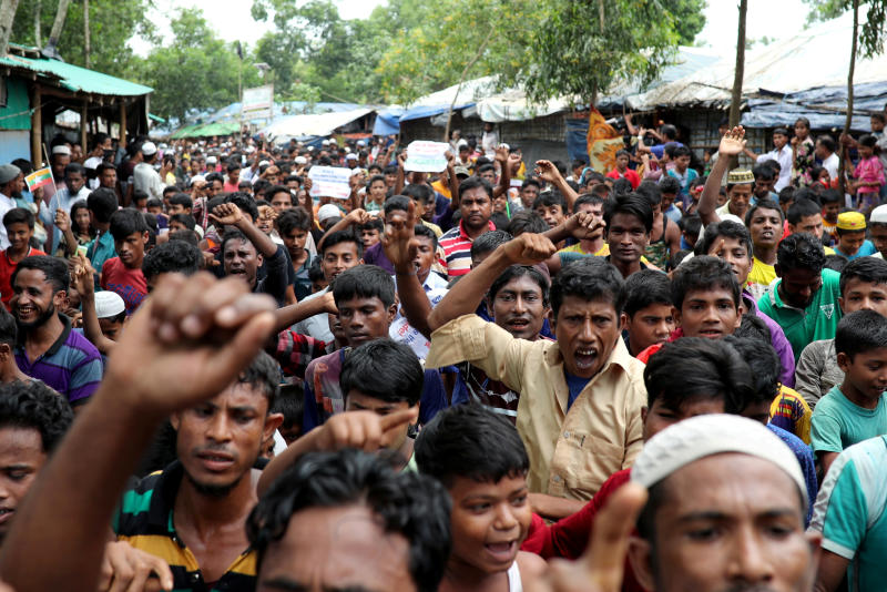 Rohingya refugees shout slogans as they take part in a protest at the Kutupalong refugee camp to mark the one year anniversary of their exodus in Cox's Bazar, Bangladesh, on Aug 25, 2018. (Reuters photo)