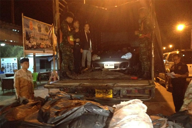 An untaxed Porsche, destined for Myanmar, is seized after it is found concealed on a six-wheel truck at a security checkpoint in Mae Sot district, Tak, in the early hours of Wednesday. (Photo by Assawin Pinitwong)