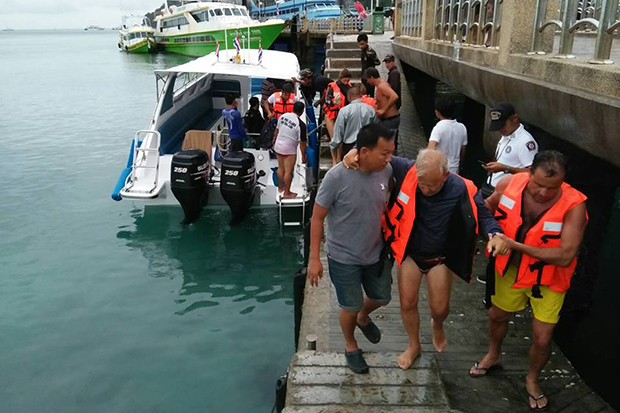 Spanish tourists are helped off a pier on Koh Phi Phi on Saturday following their rescue from a stranded catamaran. (Photo from Nopparat Tara-Mu Koh Phi Phi National Park Facebook account)