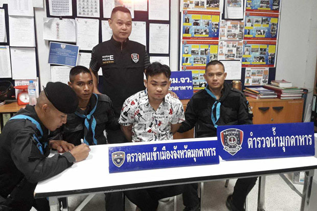The 22-year-old Lao suspect, identified only as Phu, under arrest at the immigration police office in Mukdahan province on Monday morning. (Photo supplied)