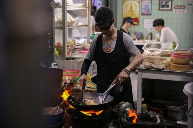 Jay Fai, or Auntie Fai, cooks at her Thailand's first street style food Michelin star restaurant, in Bangkok, March 8, 2018. (Reuters file photo)