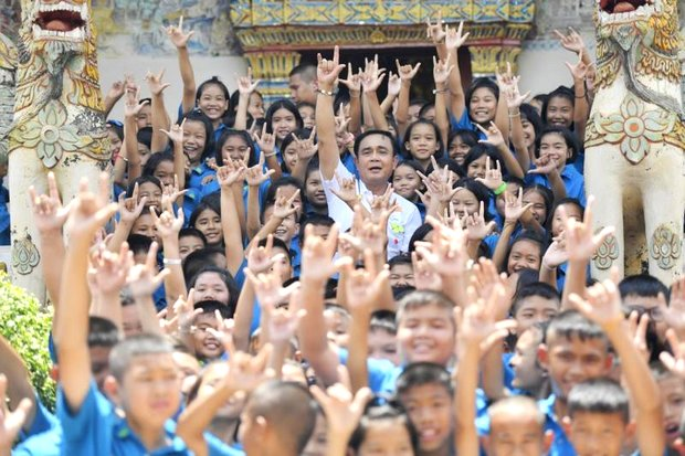 Prime Minister Prayut Chan-o-cha wound up another mobile cabinet tour Tuesday with 'impromptu' meetings with local people and children. The trip, which spokesman again insisted had no political motives, took him to the lower North and western Northeast regions, with stops in Loei and Phetchabun districts. (Photo via Government House)