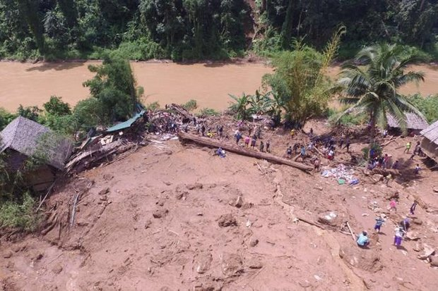 Rescuers and volunteers search Tuesday for seven people, including five children, declared missing at a Mae Hong Son refugee camp after Sunday night's mudslide. (Photo courtesy Royal Thai Army)