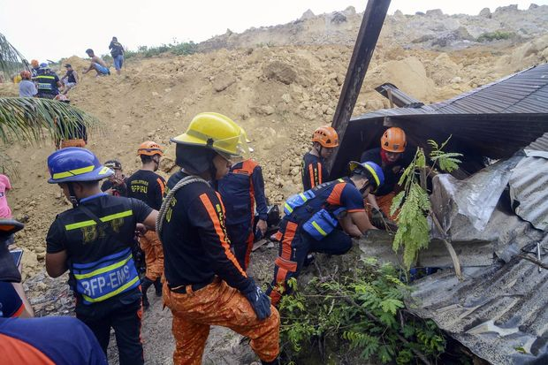 Rescuers conduct search houses for survivors after a landslide struck a village in Naga city, Cebu province central Philippines on Thursday. (AP Photo)