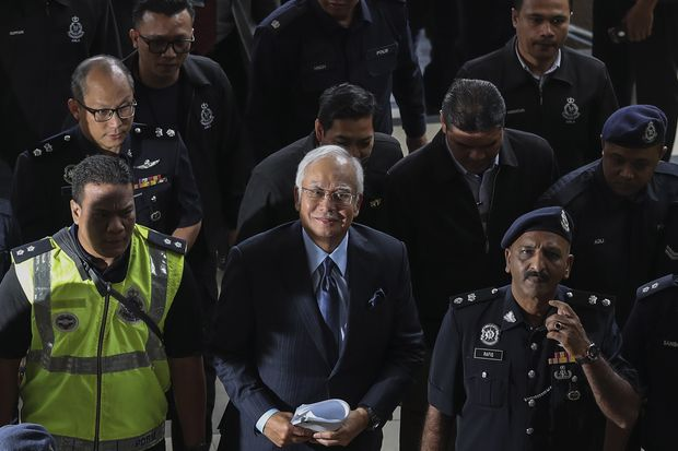 Former Malaysian prime minister Najib Razak (centre) arrives at the High Court in Kuala Lumpur on Thursday. (EPA-EFE photo)
