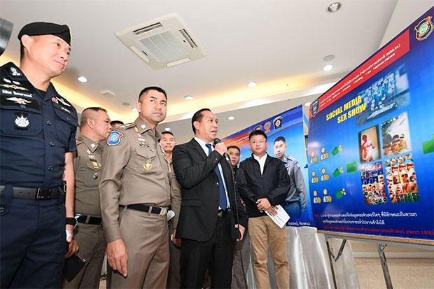 Pol Maj Gen Surachate Hakparn (first row, second left), deputy commissioner of the Tourist Police Bureau, and senior tourist police and officials, hold a media briefing about the arrest of four men for broadcasting live sexual acts via a mobile application. (Photo taken from @1155TPB Facebook page)