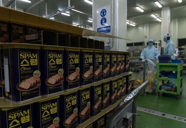 Containers of Spam are processed at a Spam factory in Jincheon, South Korea on Aug 18. (AFP photo)