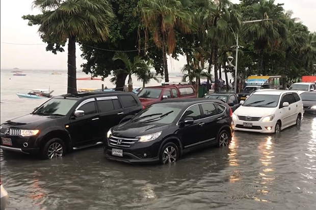 Beach road in Pattaya is flooded after a downpour on Sunday. (Photo by Chaiyot Pupattanapong)