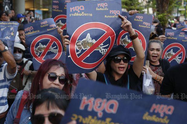 Pro-election demonstrators hold anti-junta signs near Democracy Monument on Ratchadamnoen Avenue on Feb 10 this year.