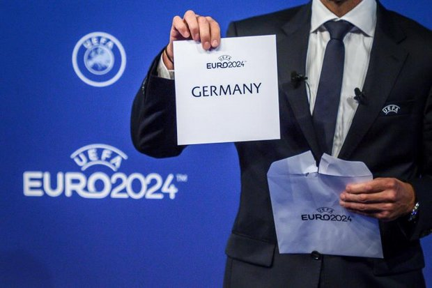 Uefa president Aleksander Ceferin shows the name of the winning country elected to host the Euro 2024 football tournament. (AFP photo)