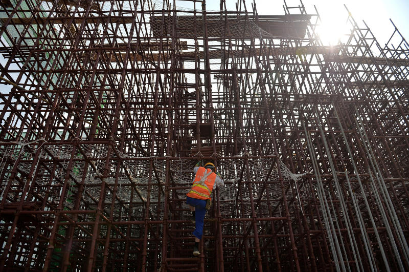 A worker climbs on steel bars at a construction site of a subway in Chengdu, Sichuan province, China, on Aug 14. (Reuters photo)