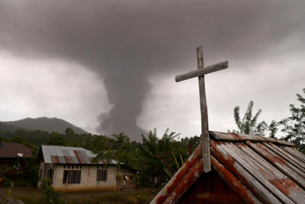 A church is seen as Mount Soputan volcano spews volcanic ash at Kota Menara village in South Minahasa, North Sulawesi, Indonesia, on Wednesday. (Antara Foto/Adwit B Pramono/ via REUTERS)