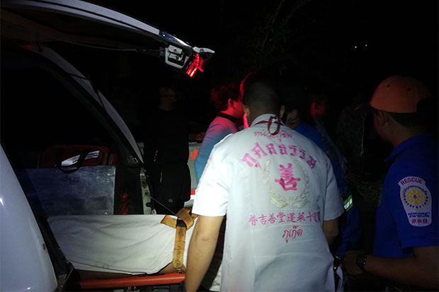 Rescue workers take the body of the 18-year-old Myanmar worker, who drowned while trying to save the life of a monkey at a swamp in Phuket, to Vachaira Hospital on Wednesday night. (Photo by Achadtaya Chuenniran)
