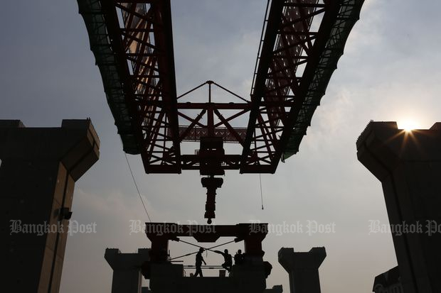 Migrant labourers work at a construction site near Bang Sue station in January this year. (Pattarapong Chatpattarasill)
