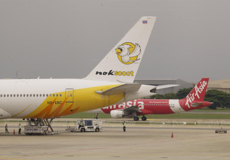 A NokScoot aircraft at Don Mueang airport, the carrier's home base. (Photo by Apichit Jinakul)