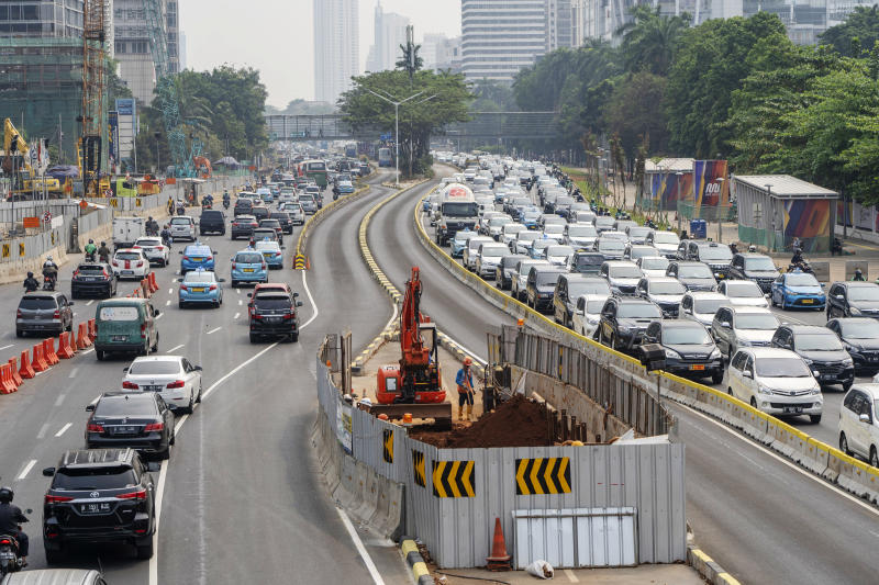 Vehicles travel along a highway past a construction site for the Jakarta Mass Rapid Transit rail system in Jakarta. (Bloomberg file photo)