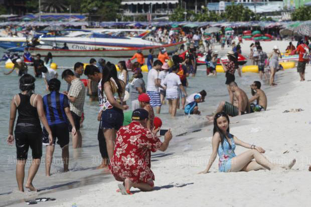 Chinese tourists hit the beach on Koh Lan off the coast of Pattaya. PATTARAPONG CHATPATTARASILL