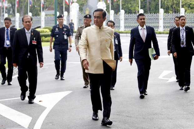 Prime Minister Prayut Chan-o-cha strikes into Government House. He seems far from having had enough of Thai politics after four years of unelected office. (AP photo)