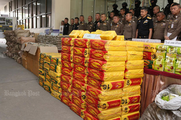 Packs of illicit drugs seized in recent police operations are displayed at the Narcotics Suppression Bureau headquarters in Bangkok during a media conference on Monday. (Photo by Apichit Jinakul)