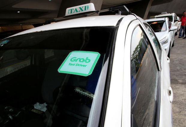 A Grab taxi queues while waiting for passengers at the Ninoy Aquino International Airport in metro Manila, Philippines, July 22, 2016. (Reuters file photo)