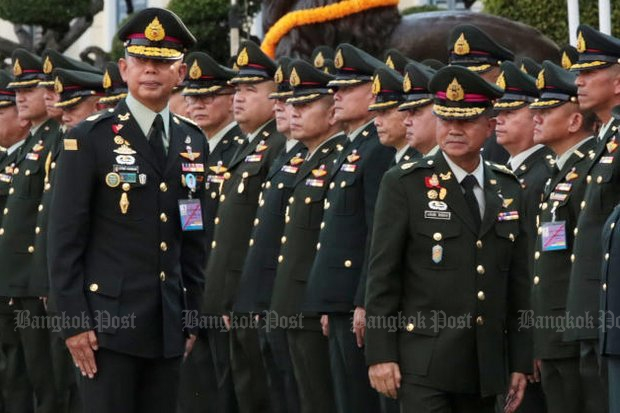Gen Apirat Kongsompong (left) assumed command of the Royal Thai Army from Gen Chalermchai Sitthisad at an official change-of-command ceremony on Sept 28 at army headquarters. (Photo by Chanat Katanyu)