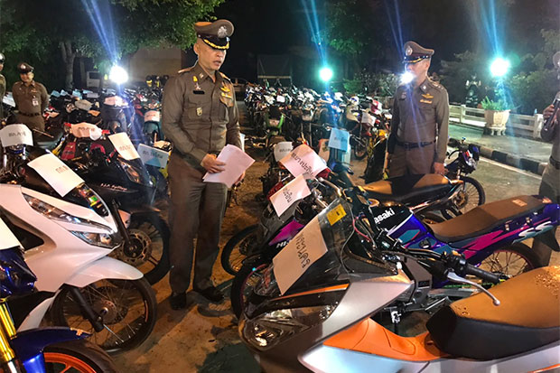 Police inspect modified motorcycles seized from street racers and shops during a crackdown on 'daek waen' racing in Ayutthaya in the early hours of Saturday during which 52 racers are arrested and 203 motorcycles seized. (Photo by Sunthorn Pongpao)