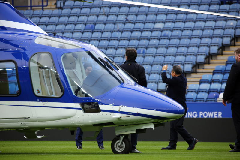 Leicester City chairman Vichai Srivaddhanaprabha (centre) walks towards his helicopter after the English Premier League soccer match between Leicester City and Southampton at The King Power Stadium on April 3, 2016. (EPA-EFE file photo)