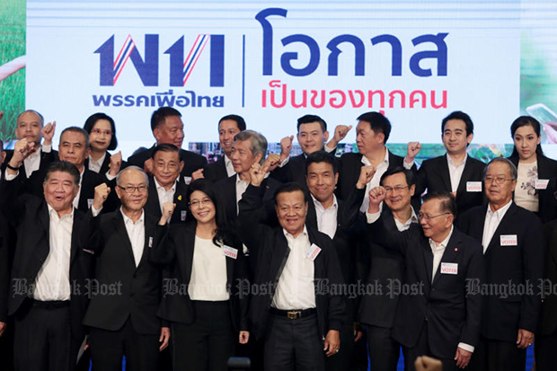 Pol Lt Gen Viroj Pao-in (front centre) was picked to head Pheu Thai at a general assembly on Sunday. (Photo by Chanat Katanyu)