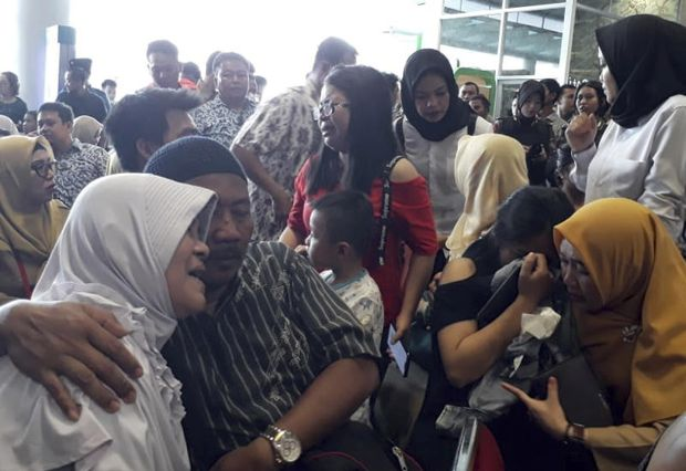 Relatives of passengers comfort each other as they wait for news on a Lion Air plane that crashed off Java Island at Depati Amir Airport in Pangkal Pinang, Indonesia on Monday. (AP photo)