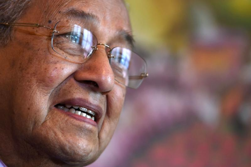 Malaysian Prime Minister Mahathir Mohamad speaks during an interview with AFP in Putrajaya on Thursday. (AFP photo)