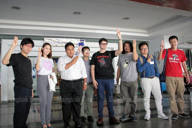 Eight well known anti-regime activists gave the three-finger salute for photographers after being formally indicted in court for illegal assembly during a protest in January. (Photo by Tawatchai Kemgumnerd)