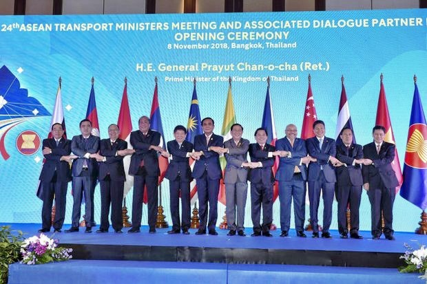 Prime Minister Prayut Chan-o-cha links arms with Asean transport ministers and high-level officials during the opening of the 24th Asean Transport Ministers Meeting and Associated Dialogue Partner Meetings in Bangkok Thursday. The meetings's purpose is to discuss regional cooperation in air, land and sea transport. (Photo courtesy Government House)