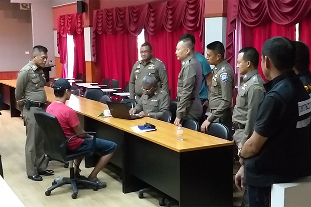 Police in Phuket interrogate Amnart Atthachak, 40, after his arrest on charges of raping a British woman in his house. (Photo by Achadtaya Chuenniran)