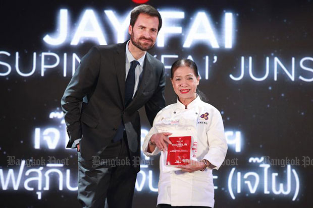Jay Fai, 70, owner of Jay Fai street food shop in Bangkok's Pratu Phi area, receives a one-star Michelin award for the second year running on Wednesday. (Photo by Phrakrit Juntawong)
