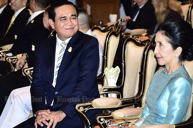 Prime Minister Prayut Chan-o-cha shares a moment with his wife Naraporn before the start of an event to mark the 112th anniversary of the Royal Thai Navy. (Facebook/Wassana Nanuam)