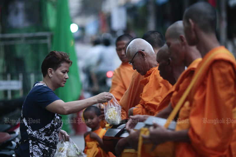 Thais seeking to earn merit and honour their ancestors often provide food to monks on their daily rounds but they can be generous to a fault. (Photo by Patipat Janthong)