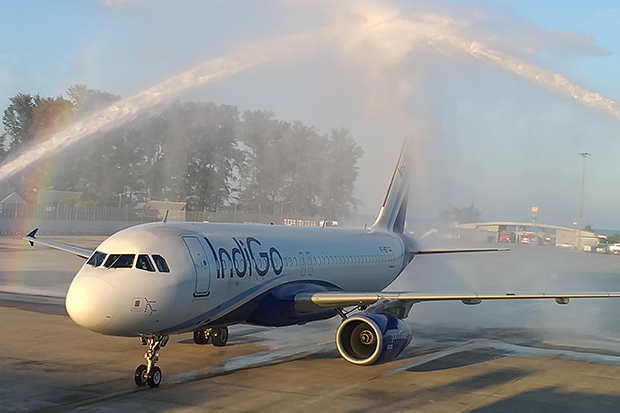 An Airbus A320 operated by Indigo Airlines taxis through a traditional water tunnel of welcome after landing at Phuket airport on its inaugural flight from Delhi on Friday. (Photo by Achadtaya Chuenniran)