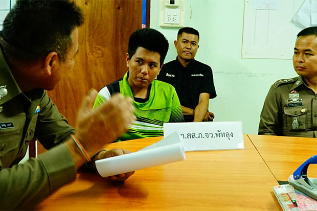 Alleged procurer Waraporn Ketnatthee, 20, is interrogated by senior police after her arrest outside a room at a love motel in Muang district of southern Phatthalung. A  14-year-old schoolgirl was inside the room waiting for a customer to arrive. (Photo by Assawin Pakkawan)