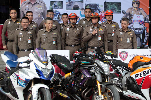 Traffic police commander Nithithon Jintakanont speaks about the arrest of big bike users at a news conference at traffic police head office in Bangkok on Friday. (Photo by Tawatchai Kemgumnerd)