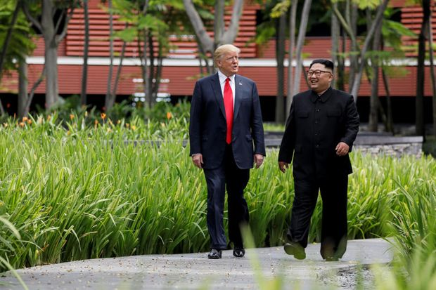 US President Donald Trump and North Korea's leader Kim Jong Un walk together before their working lunch during their summit at the Capella Hotel on the resort island of Sentosa, Singapore June 12, 2018. (Reuters file photo)