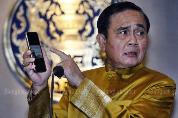 Finance Minister Apisak Tantivorawong says the plan to provide free 'Prayutphone' SIM cards is only to help low-income people access the news and farm reports - 'not watching films, playing games or listening to music'.